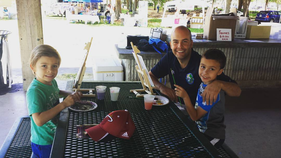 Manny Cid and his boys painting pictures for Mom at a Town event